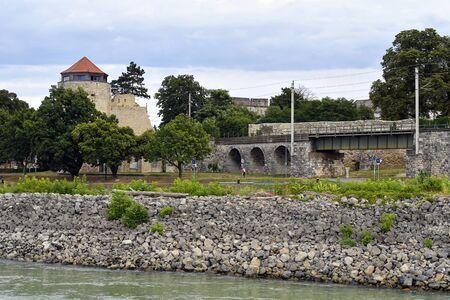 Austria, Hainburg, old watch tower in the town and railway bridge in Lower Austria