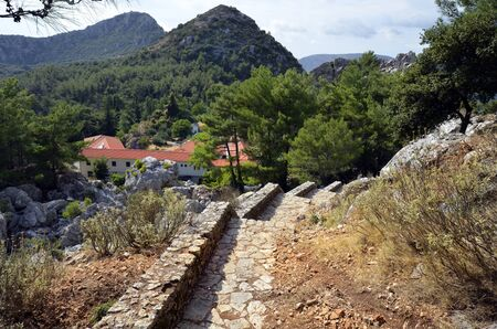 Greece, steps from monastery of Agios Dimitrios to Monument of Zalongo on top of mount Zalongo, a remembrance to a suicide from woman and children in 19th century