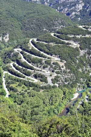 Greece, Epirus, winding mountain road to Papingo village and gorge of Voidomatis river in Pindos-Aoos national park 版權商用圖片