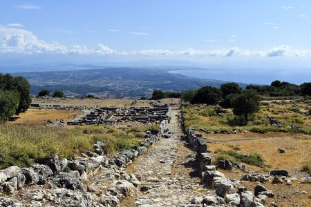 Greece, ruins of archaeological site of ancient Kassope aka Cassope, built in 4th century B.C. in the mountains of Zalongo, Ionian sea and Ambracian gulf in background 版權商用圖片