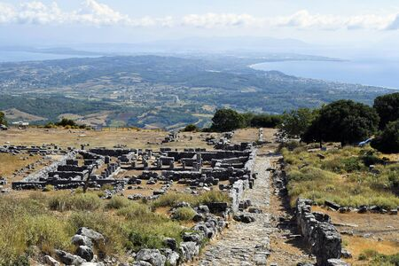 Greece, ruins of archaeological site of ancient Kassope aka Cassope, built in 4th century B.C. in the mountains of Zalongo, with view to Ionian sea and Ambracian gulf
