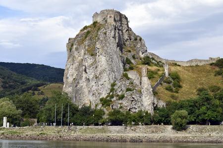 Slovakia, unidentified people walking along Danube river with medieval castle Devin 新聞圖片