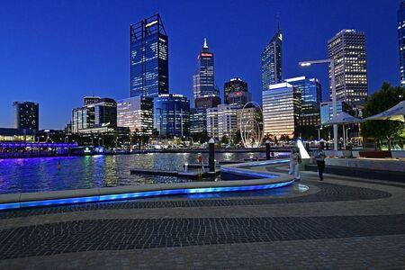Perth, WA, Australia - November 30, 2017: Illuminated Elizabeth Quay and Esplanade with different buildings at evening