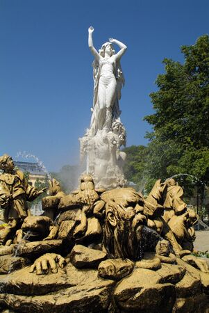 Baden, Austria - July 17, 2009: Undine Fountain in public Kurpark, the city is well knows for spa with thermal water