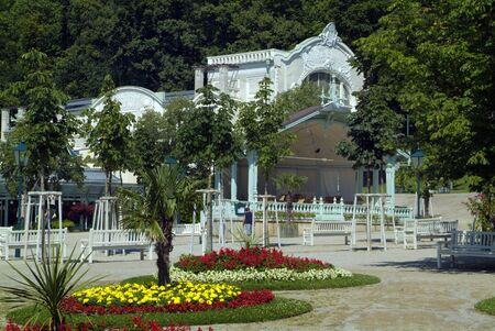 Baden, Austria - July 17, 2009: Flower beds and Summer-Arena, a performing theather in Kurpark