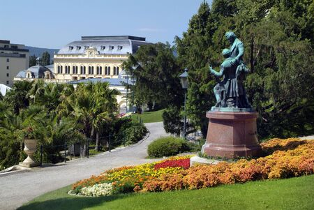 Baden, Austria - July 17, 2009: Memorial for composers and musicians Josef Lanner and Johann Strauss the elder, both well known for Vienna Waltzes, casino building in background