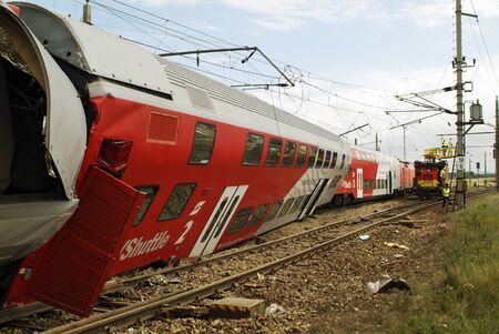 Gramatneusiedl, Austria - July 27, 2005: Unidentified workers by repair of power cables after train accident with wrecked wagons