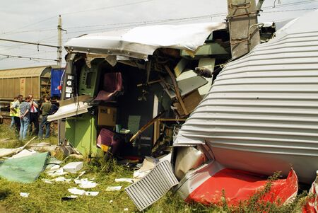 Gramatneusiedl, Austria - July 27, 2005: Unidentified people for damage expertise after train accident with wrecked wagons