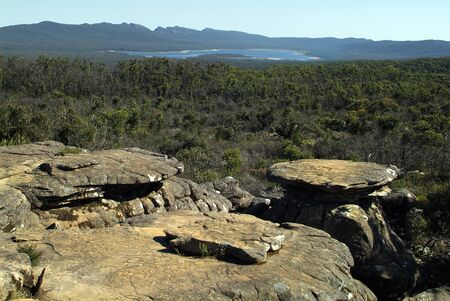 Australia, rock formations in Grampians National Park with Lake Bellfield behind