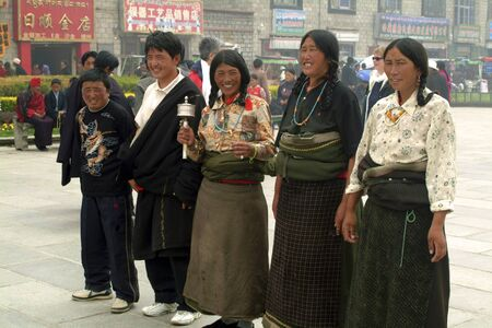 Lhasa, China - July 07, 2004: Unidentified Tibetians by pilgrimage on Yokhang Square in Tibet