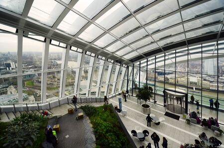 London, Great Britain - January 17th 2016: unidentified people inside the public Sky Garden with great view over the city