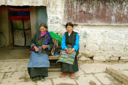 Gyantse, Tibet, China - July 09, 2004: Unidentified woman in traditional clothing and rosary at Gyantse monastery