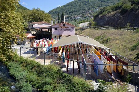 Agios Georgios, Greece - September 19, 2019: Factory for carpets and blankets washed in clear water of Louros river and drying on fresh air 新聞圖片