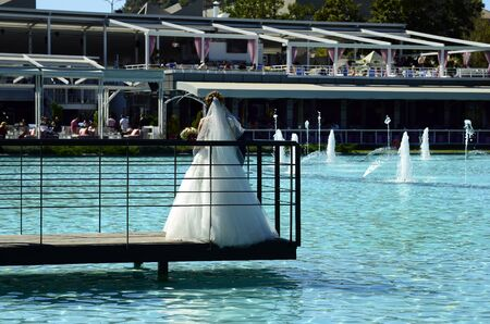 Plovdiv, Bulgaria - September 23, 2016: Unidentified bridal couple on jetty at lake named The Singing Fountains in  Tsar Simeon park