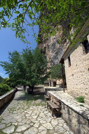 Greece, Epirus, footpath to Monastery Kipinas built in 13th Century into rock face Stock Photo