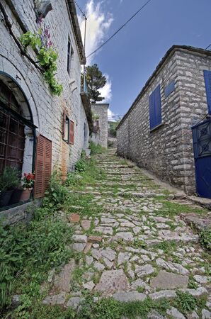 Greece, Epirus, steps and buildings in mountain village Kalarites, an Aromanian aka Vlach village in National Park of Tzoumerka, no streets for cars or trucks are in this village