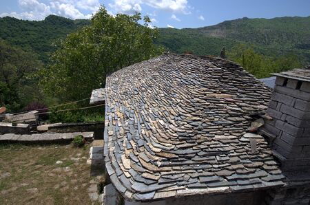 Greece, Epirus, mountain village Kalarites, an Aromanian aka Vlach village in National Park of Tzoumerka, Peristeri, Arachthos Gorge and Acheloos Valley, home covered with traditional stone shingles,