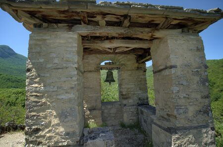 Greece, Epirus, bell tower situated on hill above Panagia Speleotissa Monastery in Vikos-Aoos National Park Standard-Bild