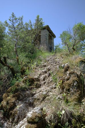 Greece, Epirus, path to bell tower situated on hill above Panagia Speleotissa Monastery in Vikos-Aoos National Park
