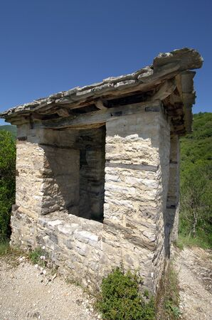Greece, Epirus, bell tower sitated on hill above Panagia Speleotissa Monastery in Vikos-Aoos National Park Standard-Bild