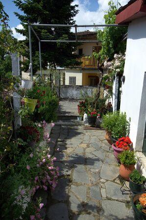 Greece, Ioannina, courtyard with flowers Stock Photo