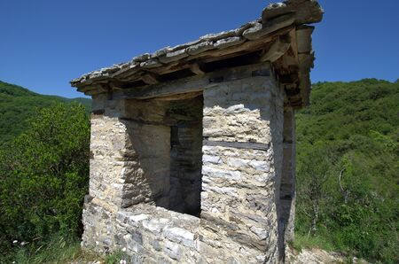 Greece, Epirus, bell tower sitated on hill above Panagia Speleotissa Monastery in Vikos-Aoos National Park Stock Photo