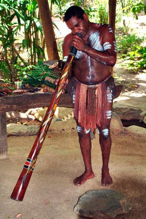 Kuranda, QLD, Australia - March 01: Unidentified aboriginal with body painting playing his traditional didgeridoo