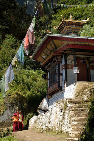 Paro, Bhutan - September 19th 2007: Unidentified monks at wayside shrine on the way to taktsang monastery - aka Tigernest