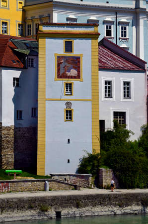 Germany, sun dial on building at Inn river promenade in the city of Passau in Bavaria near the border with Austria, the city lies at the confluence of the Danube, Ilz and Inn rivers and is therefore also called the three rivers city 写真素材
