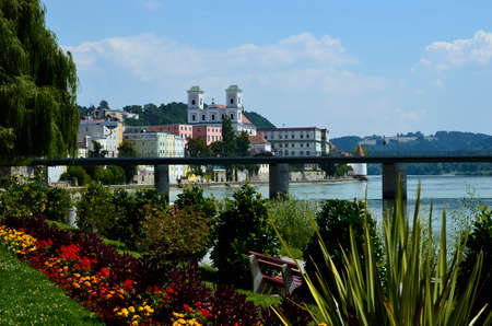 Germany, city view to old town with St. Michael church, Marienbruecke and Inn River in the city of passau in Bavaria near the border with Austria, lies at the confluence of the Danube, Ilz and Inn rivers and is therefore also called the three rivers city