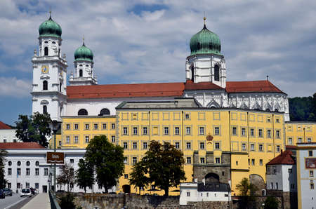 Germany, Bridge over Inn River and St. Stephen's Cathedral a baroque episcopal church in the city of Passau in Bavaria near the border with Austria, lies at the confluence of the Danube, Ilz and Inn rivers and is therefore also called the three rivers city