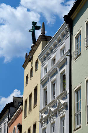 Germany, obelisk and larger-than-life bronze angel figure by Austrian sculptor Bodingbauer the work of art called Genius erected in 1930 on the roof of the house in Ludwigstrasse in the pedestrian zone in the old town of Passau
