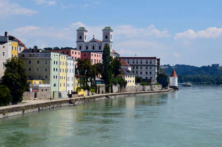 Germany, cityscape with church St. Michael of the old town district along Inn river in the city of Passau in Bavaria near the border with Austria, lies at the confluence of the Danube, Ilz and Inn rivers and is therefore also called the three rivers city 写真素材