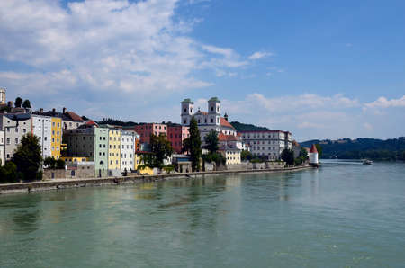 Germany, cityscape medieval Schaibling Tower and St. Michael church in old town district along Inn river in the city of Passau in Bavaria near the border with Austria, lies at the confluence of the Danube, Ilz and Inn rivers and is therefore also called the three rivers city