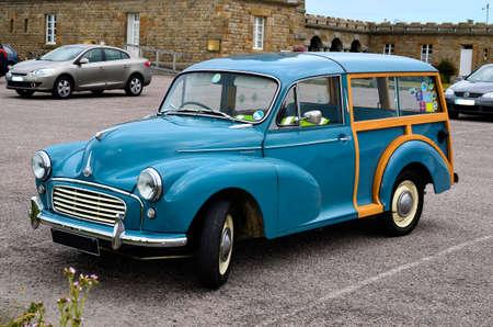 Frehel, France - June 07, 2011: vintage car Morris Minor Traveler on coast at English Channel