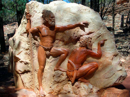 Wilpena, South Australia - January 29, 2008: Aborigine sculpture on rock on path to Wangara Lookout