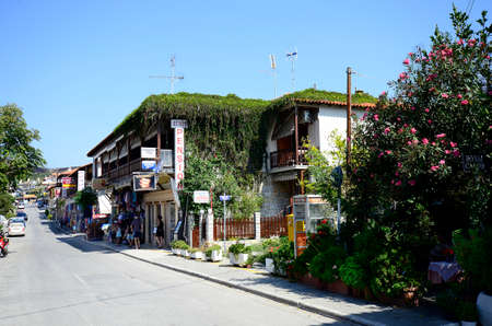 Ouranoupoli, Greece - September 27, 2012: main street with shops in the village, Ouranoupoli is the village on the border to Holy Mount Athos district 新聞圖片
