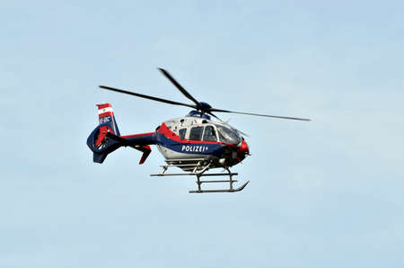 Eisenstadt, Austria - May 14, 2011: police helicopter - Eurocopter EC 135 - in operation for an accident