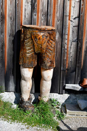 Austria, traditional loader trousers carved from a log, handcrafted in Unesco World heritage site of Salzkammergut 新聞圖片