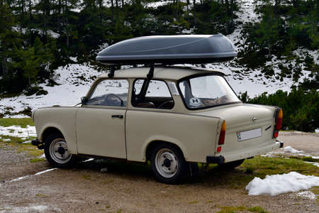 Austria, vintage car Trabant 601 with transport box on car roof on Tauplitzalm, the nickname for the car was Trabi, produced in the former Democratic Republic of Germany aka East Germany