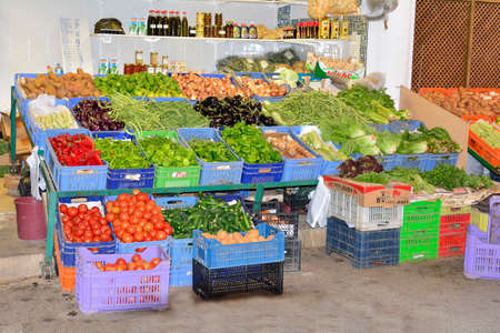 Nicosia, Cyprus - October 20th 2015: Grocery with display on street of different vegetables, fruits and goods 報道画像