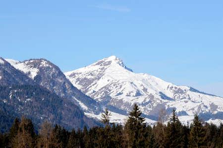 Austria, winter in Tirol with Kitzbueheler Horn - mountain summit - with transmitting station