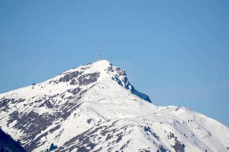 Austria, snow-covered Kitzbueheler Horn with transmitting station and chairlift