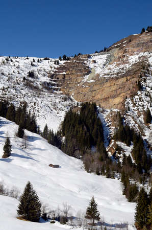 Austria, winter in Tyrol, winter landscape and rocks for terraced opencast mining of magnesite 写真素材