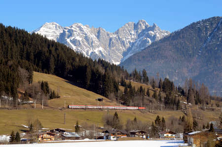 Austria, railway in front of Loferer Steinberge mountain - in Tyrol