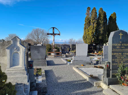 Leithaprodersdorf, Austria - February 04, 2021: cemetery in burgenland with a cross of christ Editorial
