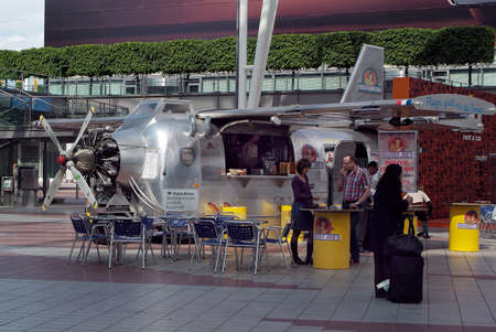 Munich, Germany - May 27, 2010: Unidentified people on Munich airport at old airplane converted into a unique snack stand