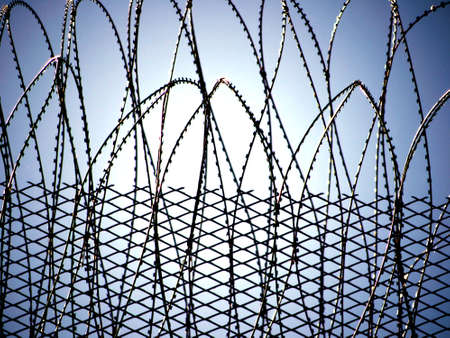 barbed hook wire: Barbed wire - part of a prison
