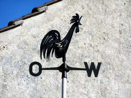 gable house: Weather-cock in front of house gable in Brandenburg, Germany Stock Photo