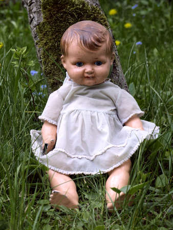old doll with porcelain head